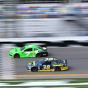 Danica Patrick, driver of the (7) GoDaddy Chevrolet, leads David Ragan, driver of the (38) Speedco Ford, during practice for the 60th Annual NASCAR Daytona 500 auto race at Daytona International Speedway on Friday, February 16, 2018 in Daytona Beach, Florida.  (Alex Menendez via AP)