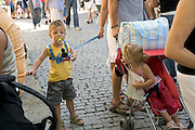 child on a leash at a crowded tourist destination site France