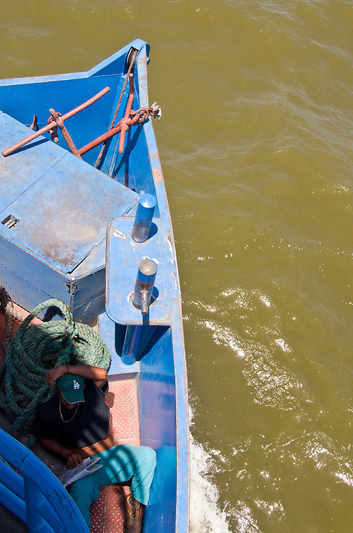 .Riding the ferry from Isla de Ometepe to San Jorge, Nicaragua.  Lago de Nicaragua is so big it has it's own tides, and often has as ruff of waters as some seas.  May 2009.  (Photo/William Byrne Drumm)