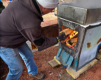 Adding wood to the new maple syrup concentrator. Image taken with a Leica TL camera and 18-56 mm zoom lens