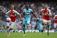 Diafra Sakho of West Ham United is chased by Nacho Monreal of Arsenal (l) and Laurent Koscielny of Arsenal ® Barclays Premier League, Arsenal v West Ham Utd at the Emirates Stadium in London on Sunday 9th August 2015.<br /> pic by John Patrick Fletcher, Andrew Orchard sports photography.