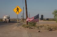 People crossing warning sign in Mentone, Texas in the Permain Basin.