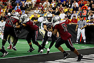 4/12/2007 - David Short (12) flips the ball to running back Brandon Warfield in the Alaska Wilds 33 - 46 loss to the Frisco Thunder in the first professional football game in Alaska.
