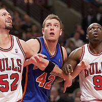 17 December 2009: Chicago Bulls center Brad Miller, New York Knicks center David Lee and Chicago Bulls forward Luol Deng fight for the rebound during the Chicago Bulls 98-89 victory over the New York Knicks at the United Center, in Chicago, Illinois, USA.