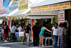 07 May 2010. Westwego, Louisiana. <br /> Westwego Fish Market. All seafood prices have risen 25% in the past 7 days alone as stocks run low thanks to closed fishing grounds affected by oil pollution. Today was the opening day of the inshore shrimp season. The season was closed before it could open thanks to BP's disastrous environmental catastrophe out in the Gulf of Mexico. Approximately 210,000 barrels of oil per day is leaking uncontrollably into the Gulf because of the explosion and collapse of the Deepwater Horizon drilling platform 46 miles out to sea. The closure of fishing grounds both east and west of the Mississippi river outflow is crippling thousands of local fishermen and all affiliated businesses and families who rely on the seafood industry. None of the shrimp or other seafood offered at the market are fresh catch from today. Everything has been through the IQF (Instant Quick Freeze) process and is seafood caught earlier in the season and brought from storage freezers in Venice and Grand Isle. Stocks are running low. With no new catches, the market will be forced to rely on farmed shrimp shipped in from Texas and Georgia. Local traders refuse to stock Chinese import fish raised with growth hormones, pesticides, fungicides and other contaminants widely found in Chinese farm raised seafood. Many fear losing their jobs and everything they own as a result of BP's Gulf Coast environmental disaster.<br /> Photo credit;Charlie Varley/varleypix.com