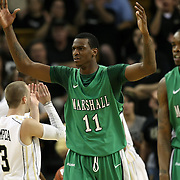 Marshall center Nigel Spikes (11)  and Marshall forward Tirrell Baines (30) react to a foul call during a Conference USA NCAA basketball game between the Marshall Thundering Herd and the Central Florida Knights at the UCF Arena on January 5, 2011 in Orlando, Florida. Central Florida won the game 65-58 and extended their record to 14-0.  (AP Photo/Alex Menendez)