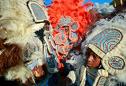 29 August 2013. Lower 9th Ward, New Orleans, Louisiana.<br /> Hurricane Katrina memorial 8 years later. <br /> Mardi Gras Indians L/R; Vernon Freeman, Charlie Tenner Jr and Michael Tenner (9 yrs) of the Comanche Hunters help to celebrate the lives of those lost to Katrina in an event funded by Brad Pitt's 'Make it Right' Foundation.  <br /> Photo; Charlie Varley