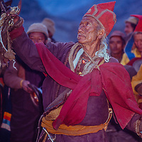 A Tibetan Bhuddist lama exorcises bad spirits and demons duribg a blessing ceremony in the remote village of Braga, now part of the Around Annapurna trek.