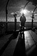France. paris. 7th district.  the Eiffel tower, la tour Eiffel, des touristes admirent le panorama de Paris au coucher du soleil