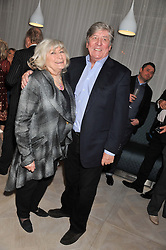 CHARLES & TITA CARTER at a party to celebrate the publication of Fame Game by Louise Fennell held at Grace, West Halkin Street, London on 12th March 2013.