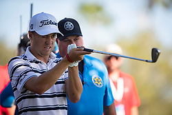 February 28, 2019 - Palm Beach Gardens, Florida, U.S. - Justin Thomas checks his 9 iron after hitting into a tree on the 10th hole during the first round of the Honda Classic Thursday at PGA National Resort and Spa in Palm Beach Gardens, February 28, 2019. (Credit Image: © Allen Eyestone/The Palm Beach Post via ZUMA Wire)