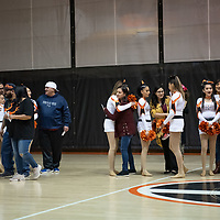 Parents of the Gallup Dance Team hug their daughters at center court in the Gallup High School gym on Thursday. The dance team will leave for Albuquerque to compete in the state dance tournament next week.