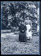 two aldult woman in garden setting Frnce ca 1920s