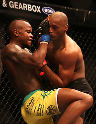 Tumisang Madiba (Blue) knees Sindile Manengela (Red) during the eighth bout of the Extreme Fighting Championships, EFC 52 held at the Grand West Casino in Cape Town, South Africa on the 5th August 2016<br /> <br /> Photo by:   Shaun Roy / Real Time Images