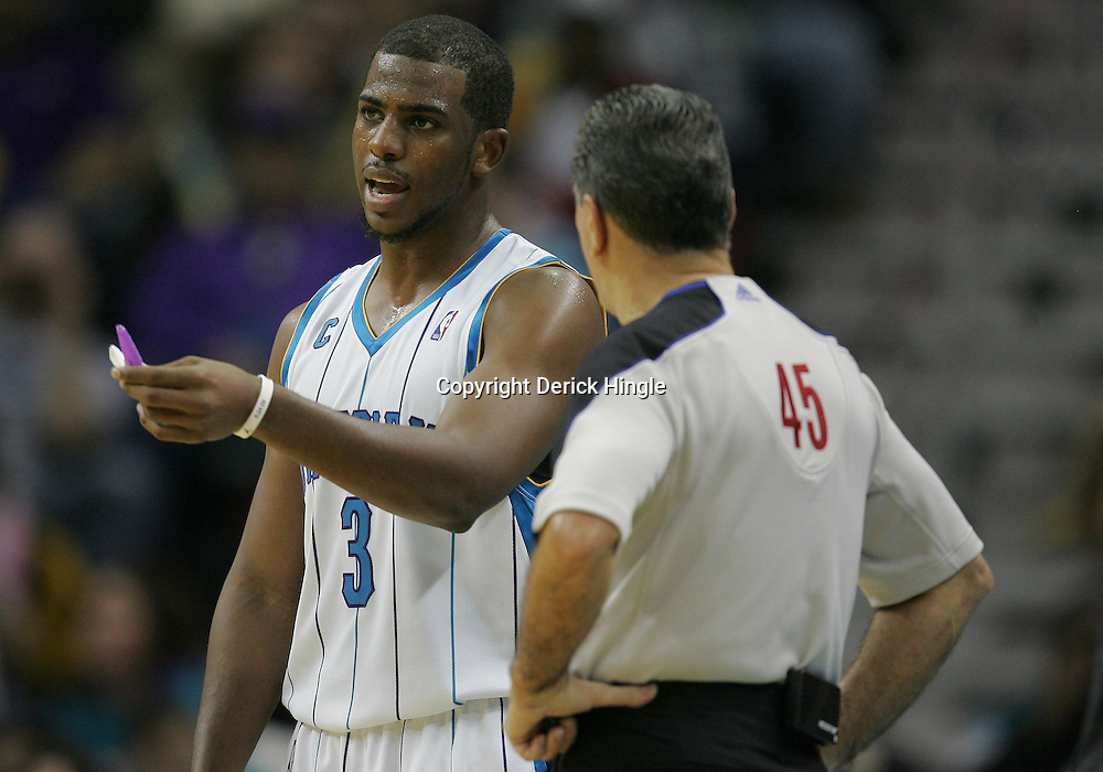 Dec 30, 2009; New Orleans, LA, USA;  New Orleans Hornets guard Chris Paul (3) talks with official Joe Forte (45) during the second half at the New Orleans Arena. The Hornets defeated the Heat 95-91. Mandatory Credit: Derick E. Hingle-US PRESSWIRE