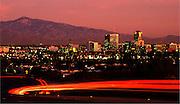 Lights from braking vehicles brighten West Speedway Boulevard in Tucson, Arizona, USA.