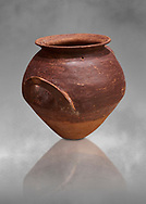 Hittite  terra cotta pot woth two handles. Hittite Period, 1600 - 1200 BC.  Hattusa Boğazkale. Çorum Archaeological Museum, Corum, Turkey. Against a grey bacground. .<br />  <br /> If you prefer to buy from our ALAMY STOCK LIBRARY page at https://www.alamy.com/portfolio/paul-williams-funkystock/hittite-art-antiquities.html  - Hattusa into the LOWER SEARCH WITHIN GALLERY box. Refine search by adding background colour, place,etc<br /> <br /> Visit our HITTITE PHOTO COLLECTIONS for more photos to download or buy as wall art prints https://funkystock.photoshelter.com/gallery-collection/The-Hittites-Art-Artefacts-Antiquities-Historic-Sites-Pictures-Images-of/C0000NUBSMhSc3Oo