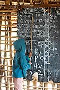 Africa, Tanzania, Maasai tribe an ethnic group of semi-nomadic people Rural school children learn to read and write and arithmetic