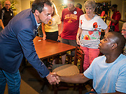 10 JULY 2019 - MARSHALLTOWN, IOWA: Governor STEVE BULLOCK (D-MT) talks to an individual voter during a campaign stop at a cafe in Marshalltown Wednesday. Gov. Bullock is in a crowded field of Democrats vying to be the party's Presidential nominee in 2020. Iowa traditionally hosts the the first election event of the presidential election cycle. The Iowa Caucuses will be on Feb. 3, 2020.        PHOTO BY JACK KURTZ