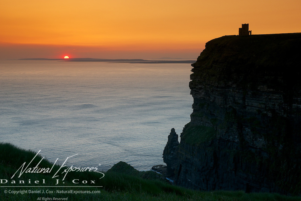 Sunset beyond the Cliffs of Moher, Ireland.