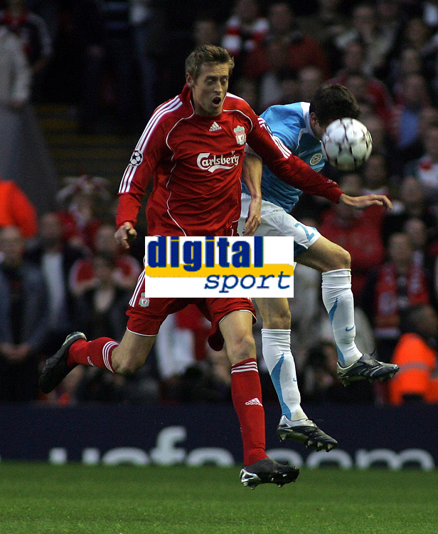 Photo: Paul Thomas.<br /> Liverpool v PSV Eindhoven. UEFA Champions League. Quarter Final, 2nd Leg. 11/04/2007.<br /> <br /> Peter Crouch (Red)  of Liverpool battles with Csaba Feher.