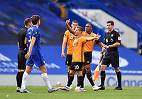 Football - 2019 / 2020 Premier League - Chelsea vs. Wolverhampton Wanderers<br /> <br /> Wolverhampton Wanderers players frustrated with Referee Stuart Attwell at the final whistle after their 2-0 defeat, at Stamford Bridge.<br /> <br /> COLORSPORT/ASHLEY WESTERN