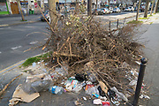 """March, 30th 2020 - Paris, Ile-de-France, France: Rubbish left on the streets during the spread of the Coronavirus, during the eleventh day of near total lockdown imposed in France. A week after President of France, Emmanuel Macron, said the citizens must stay at home for at least 15 days, now extended a furhet two weeks. He said """"We are at war, a public health war, certainly but we are at war, against an invisible and elusive enemy"""". All journeys outside the home unless justified for essential professional or health reasons are outlawed. Anyone flouting the new regulations is fined. Nigel Dickinson"""