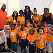 "First Lady Michelle Obama and Charlie Crist pose with children and teachers from the Favored Touch Preschool after the grassroots ""Commit to Vote"" rally for Democrat at the Barnett Park Gymnasium in Orlando, Florida on Friday, Nov. 17, 2014. (AP Photo/Alex Menendez)"