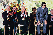 Artistic Director of the Miami City Ballet Edward Villella, right, stands as he is called to receive his National Medal of Arts award during a ceremony on the South Lawn of the White House September 29, 1997 in Washington, DC. Sitting left to right are: Percussionist Tito Puente, Jean Louis Bourgeois, Actor Jason Robards, Singer Betty Carter and Villella.