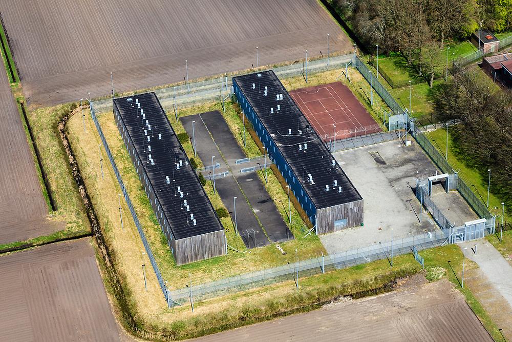 Nederland, Drenthe, Gemeente Noordenveld, 01-05-2013; gevangenisdorp Veenhuizen, gesticht in 1823 door de Maatschappij van Weldadigheid voor de heropvoeding van bedelaars en landlopers. Nieuwe cellenblokken onderdeel van Penitentiaire Inrichting (PI) Veenhuizen.<br /> Veenhuizen prison village, founded in 1823 by the Benevolent Society for the rehabilitation of beggars and vagrants. Newly build cell blocks, part of detention center.<br /> luchtfoto (toeslag op standard tarieven)<br /> aerial photo (additional fee required)<br /> copyright foto/photo Siebe Swart