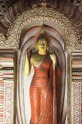 Buddha figure inside Dambulla cave Buddhist temple complex, Sri Lanka, Asia