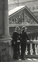 Undated file photo showing Bank of England staff on fire-watch looking out over Threadneedle Street. For the Bank of England VE-Day brought to an end an extraordinary effort to protect its crucial work. Adhering to the wartime spirit of 'business as usual', as many as 1,000 staff at a time in Threadneedle Street had been working two or three days in a row, sleeping overnight in the vast vaults. Those still in London would do a full day's work and then go up on the roof of the building to watch for fires started by falling bombs.