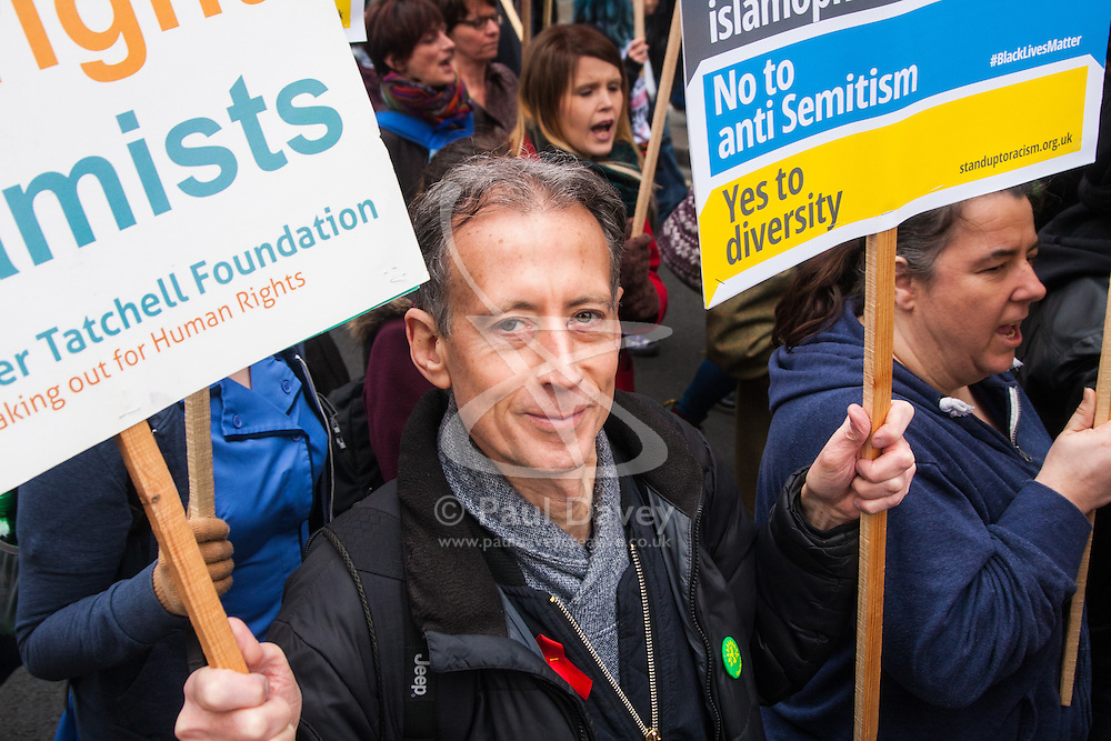 London, March 21st 2015. Thousands of people from across the UK march along Regent Street in the Stand Up To Racism protest. PICTURED: LGBT and human rights campaigner Peter Tatchell marches with the crowd.