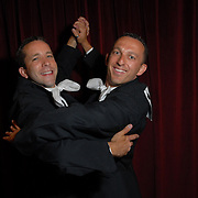 ****EMBARGO: NOT FOR PUBLICATION IN THE ADVOCATE, CURVE, GONYC OR OUT MAGAZINES..Gay ballroom dancers Michael Herman, left, and Abdallah Karam, both of Chicago, Illinois, pose for a photo during the Dancesport (ballroom dancing) competition at the Hilton Hotel and Towers in downtown Chicago during Gay Games VII on July 19, 2006. ..They have been dancing partners for 14 months. ..Over 12,000 gay and lesbian athletes from 60 countries are in Chicago competing in 30 sports during the Games from July 15 through 22, 2006. ..Over 50,000 athletes have competed in the quadrennial Games since they were founded by Dr. Tom Wadell, a 1968 Olympic decathlete, and a group of friends in San Francisco in 1982, with the goal of using athletics to promote community building and social change. ..The Gay Games resemble the Olympics in structure, but the spirit is one of inclusion, rather than exclusivity. There are no qualifying events or minimum or maximum requirements...The Games have been held in Vancouver (1990), New York (1994), Amsterdam (1998), and Sydney (2002). .
