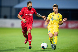 Gregor Sikosek  of NK Domzale and Uros Ljubimirac of FC Balzan during 2nd Leg Football match between NK Domzale and FC Balzan  in First Qualifying match of UEFA Europa League 2019/2020, on July 18, 2019 in Sports park Domzale, Domzale, Slovenia. Photo by Ziga Zupan / Sportida