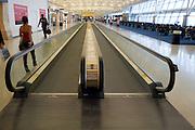 walking band escalator at a JFK airport  terminal