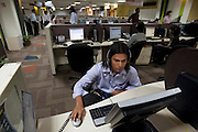 Shashi Kanth, a call center worker, at his workstation at the AOL call center in Bangalore, India. (Shashi Kanth is featured in the book What I Eat: Around the World in 80 Diets.)  MODEL RELEASED.