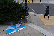 A collapsed umbrella lies abandoned on the ground at Bank triangle in the City of London after strong gusts of wind from Storm Ellen passed through the capitals financial district, on 21st August 2020, in London, England.