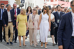 Brigitte Macron, wife of French President Emmanuel Macron, and Espelette mayor Jean-Marie Iputcha walk in the streets with U.S. First Lady Melania Trump , Akie Abe, wife of Japan's Prime Minister Shinzo Abe, Chile's First Lady Cecilia Morel, Jenny Morrison, wife of Australia's Prime Minister Scott Morrison, Malgorzata Tusk, wife of European Council President Donald Tusk during a visit on traditional Basque culture in Espelette, near Biarritz as part of the G7 summit.August 25, 2019. Photo by Thibaud Moritz/ABACAPRESS.COM