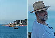 Editorial Travel Photography: Portrait of man and view of a yacht on Antibes Coastline, french riviera, Cote d'Azur, France