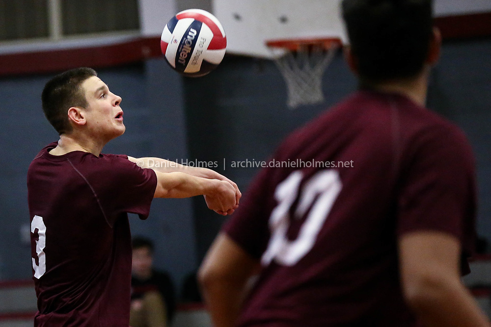 (5/9/17, MILLIS, MA) Millis' Carter Burruss bumps the ball during the boys volleyball game against Nipmuc at Millis High School on Tuesday. [Daily News and Wicked Local Photo/Dan Holmes]