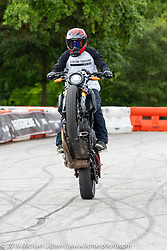 Tony Carbajal entertained the crowds stunting his Indian FTR 1200 during the Revival and Roland Sands sponsored races in the parking lot of the Austin American Statesman outside the Handbuilt Show. Austin, Texas USA. Saturday, April 13, 2019. Photography ©2019 Michael Lichter.