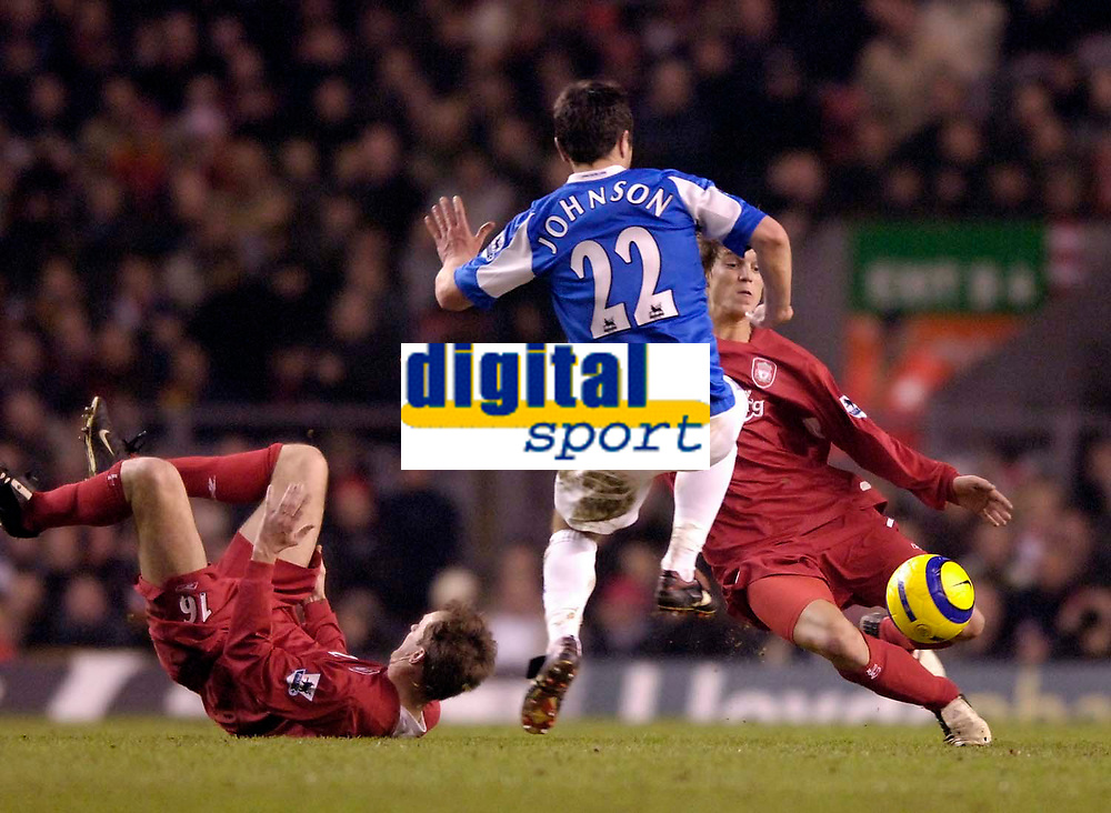 Photo: Jed Wee.<br />Liverpool v Birmingham City. Barclays Premiership. 01/02/2006.<br />Birmingham's Damien Johnson dives into Liverpool Daniel Agger (R) for a tackle that sees him receive the red card.