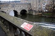 No diving sign, Pulteney Bridge on the River Avon, Bath, England