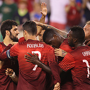 Portuguese players celebrate a goal from Hugo Almeida  during the Portugal V Ireland International Friendly match in preparation for the 2014 FIFA World Cup in Brazil. MetLife Stadium, Rutherford, New Jersey, USA. 10th June 2014. Photo Tim Clayton