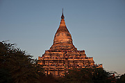 Tourists see the sunset from Shwesadaw temple, in Bagan, Burma<br />