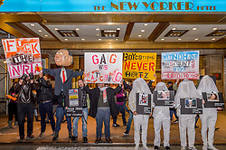 November 28, 2016 - New York, United States - Protest at Windham New Yorker Hotel in Midtown Manhattan - In a protest at FedEx, Hertz, and Wyndham Worldwide locations in Midtown Manhattan, Gays Against Guns, a direct action group committed to end gun violence in America, will demand that the three companies halt their generous discounts for NRA members because some of the money that NRA members save with FedEx, Hertz, and Wyndham ends up in the NRA's bank account. That same NRA bank account siphons money straight to the gun lobby's bank account. (Credit Image: © Erik Mcgregor/Pacific Press via ZUMA Wire)