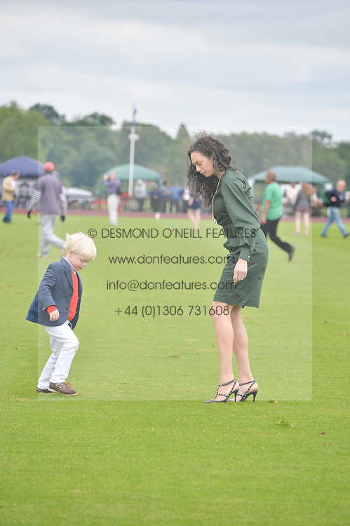 LILLY BECKER and her son AMADEUS BECKER at the Cartier Queen's Cup Final polo held at Guards Polo Club, Smith's Lawn, Windsor Great Park, Egham, Surrey on 15th June 2014.