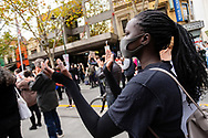 A black woman claps and marches in the streets during a Black Lives Mater rally on 06 June, 2020 in Melbourne, Australia. This event was organised to rally against aboriginal deaths in custody in Australia as well as in unity with protests across the United States following the killing of an unarmed black man George Floyd at the hands of a police officer in Minneapolis, Minnesota. (Photo by Dave Hewison/ Speed Media)