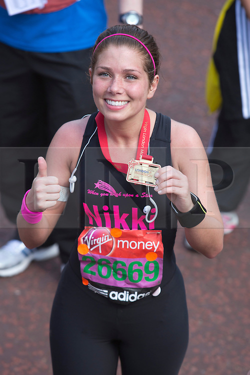 © Licensed to London News Pictures. 21/04/2013. London, England. Picture: Coronationl Street actress Nikki Sanderson..Celebrity Runners and Fun Runners finish the Virgin London Marathon 2013 race in the Mall, London. Many wore black ribbons to pay their respect for those who died or were injured in the Boston Marathon. Photo credit: Bettina Strenske/LNP
